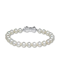 This pretty 7-inch bracelet features a lustrous strand of freshwater cultured pearls from the Sea Magic Cultured Pearls® by Mikimoto collection, each measuring 6 to 6.5 mm. The sterling silver clasp adds a touch of artistry. Included with the purchase is a special box for this fine jewelry bracelet, as well as a Certificate of Authenticity.