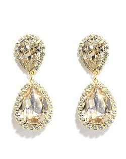 """This gold silk crystal double pear drop is a beautiful warmer addition to a formal or bridal look. This Swarovksi color called """"Silk"""" compliments and picks up hues from ivory, champagne, pink, peach, brown and coral. Set in 18K gold plate."""