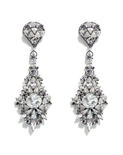 The light reflects beautifully off these impressive statement earrings. Swarovski cushions cut crystal in the center is surrounded by various shaped crystals set on rhodium filigree. Crystal encrusted post adds to the earrings formality. The perfect finishing touch for the glamorous bride.