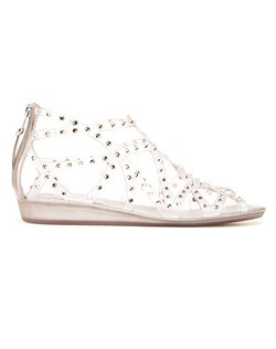 Clear jelly gladiator sandal adorned with matching rhinestones. Jellies continue to dominate the summer It-List, and this global glamazon version will take you way beyond the beach. We envision these with a crisp white minidress and bold silver earrings for a dazzling date night.