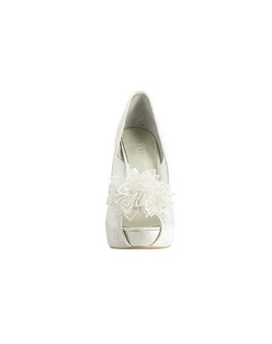 "Walk down the isle in the Adelia by Menbur. A gorgeous peep toe pump style with flower accent at the toe that will surely turn heads. The sheer patterned side fabric is sexy and sweet the satin edge gives this bridal shoe the finishing touch. The heel is about 4"" with a 1/2"" platform front."