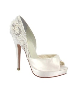 The Narke by Menbur is simply stunning. The open sandal toe is soft and simple.  The heal is the spotlight of this bridal shoe.  The D'Orsay heel is encrusted with beading, rhinestones in both Ivory and Silver creating a  master piece. The heel measures about 4.5 with a 1/2 platform front.