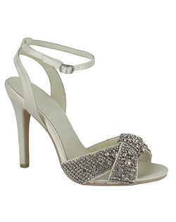 "Dance the night away! The Alex by Menbur is a gorgeous rhinestone encrusted sandal that is simply hot. A simple sandal design that is heavily encrusted at the toe with crystals of different sizes really makes this shoe pop. The ankle strap offers additional support for the 4"" heel. Available in Ivory."