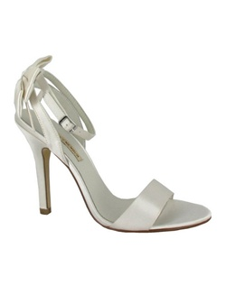 "Sexy simple, Belli by Menbur is a wedding day must have! This strappy sandal makes a statement. The plain strap toe allows the strappy heel and bow embellishment to take center stage. The satin bow is absolutely adorable. Heel height measures about 3"". Available in Ivory."