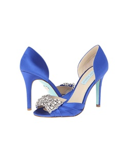 "Looking for something blue? We love the Betsey Johnson Something Blue Gown in Royal Blue. Fully encrusted bow embellishment at the toe is outof this world stunning, you will be turning heads all night long. The simple design of the open toe, D Orsay pump lets the bow design take center stage. The heel height is 4"" with a beautiful blue sole."