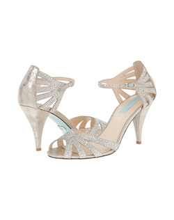 "Sexy, simple and SWEET, The Betsey Johnson bridal shoe is a must have!  Perfect match for your wedding day or a night on the town. This strappy sandal has a 3"" heel, adjustable strap, and buckle closure. Also features the signature something blue sole."