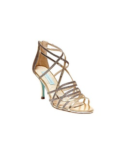 "Looking for a sexy bridesmaid sandal? Girls night out? The Crown by Betsey Johnson is a 3"" heel ,sexy, strappy sandal perfect for any occasion. The multi strap design features metallic and glittered detailing for an amazing contrasting effect.  The closed zip back offers comfort and support to this style."