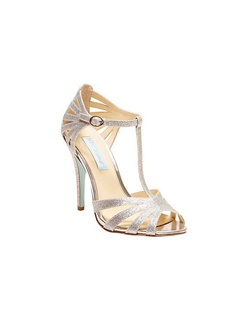 "Looking for a versatile sexy sandal? The Silver Tee by Betsey Johnson is the perfect T-strap sandal. The stunning glittered encrusted sandal is perfect for your BIG day! Even great for bridesmaids, or a night out on the town with your girls.  Heel height measures 4""."