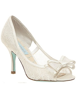 "This bridal heel is sweet as can be! The Betsey Johnson Hope adorable! A cute lace peep toe pump perfect for any wedding attire. The full lace design and double fold bow is romantic and polished. Satin trim finishes the look for an elegant fit and design. The heel height measures a perfect 3 3/4"" with a covered heel. And of course features the signature blue sole!"