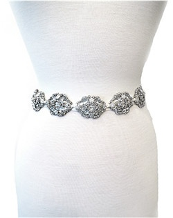 Ribbon runs through these beautiful ornate Swarovski embellished brooches. This piece is truly a masterpiece and can be worn as a bridal sash/belt or as a headband. The detail on this design is unmatched with Swarovski crystals even adorning the ends of the ribbon! A perfect addition to your gown! Please select antique white (pale ivory) or white ribbon.