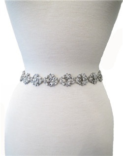 This Maria Elena design is spectacular and oh so sparkly! Swarovski rhinestones adorn silver filigree with subtle accents of mother of pearl. Ribbon is intertwined throughout the filigree to create this beautiful work of art! This can be worn as a sash, belt or headpiece. Please select antique white (pale ivory) or white.