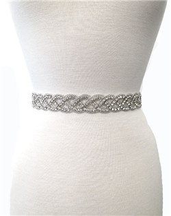 Glimmering rhinestones in a swirling braid add the perfect touch to your gown! Ribbon is sheer organza and available in white, ivory, or black.