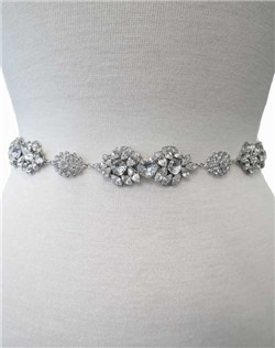 Glittering petals of faceted Swarovski crystal trickle across a base of exquisite filigree forming a perfect linked bridal belt. This can be worn again and again after the wedding! Please select pale ivory or diamond white ribbon.