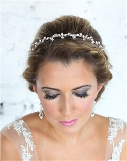 Sparkling crystal navettes grace this silver headband/tiara, giving a feminine bridal look. Set in silver plate.