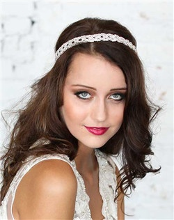 This crystal braided headpiece can be worn in several ways including a headband or halo! Hundreds of tiny crystals sparkly in the light! Bonus-this headpiece can be worn again and again!