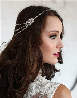 Embrace your inner goddess with this bohemian-inspired head chain, which features a multi-chain drop in the back. Swarovski crystal and freshwater pearl brooches on each side add to this romantic look. Chain has crystals throughout. Rhodium plate.