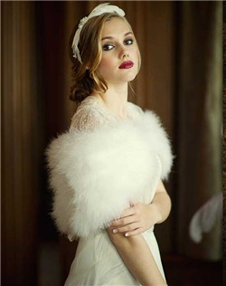 This vintage inspired genuine marabou feather bridal shrug is a beautiful addition to your fall or winter wedding. Luxuriously feminine and romantic, this beautiful wrap is breathtakingly gorgeous. Crafted with high quality marabou feathers with a hook and eye fastener.