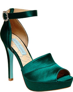 Satin upper,  man made lining, wrapped platform and heel, adjustable back closure