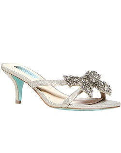 Textile upper/synthetic lining and sole, crystalized bow at top strap, with a 2 inch heel