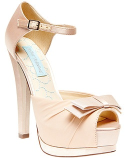 Satin upper, peep toe design with bow detail, slender buckle around ankle strap, sculpted stilleto heel