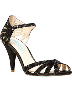 Textile upper/synthetic lining and sole, 3 inch heel with an adjustable strap with buckle closure