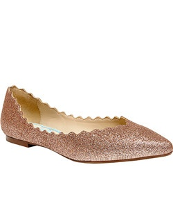 • Glitter fabric upper, closed pointed toe,scalloped edging with a man made sole