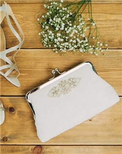 Inspired by old world refinement, a lustrous medallion of intricate beading, rhinestones and pearls adorns delicate ivory lace. An exquisite bridal clutch for all those wedding day essentials. Ivory lace atop Ivory and gorgeous gray sage for the lining. A shiny nickel clasp is the finishing touch.