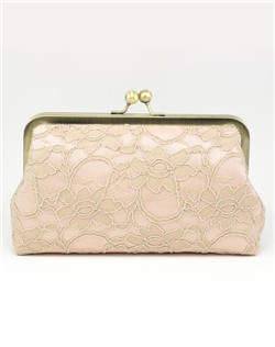 Taking cues from classic French lingerie, the Antoinette Clutch is draped in delicate lace, adding interest and texture.