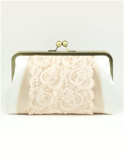 A dreamy sandwich of crisp dupioni silk, lace and pearly silk with a satin finish. This delicate clutch is all about the details.