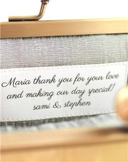 This is an add-on for a personalized message label stitched on the inside of your clutch. The label is white with black lettering.