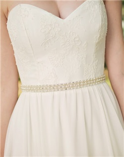 Glistening rows of pearls, rhinestones and delicate beading alternate along this length of this luxe bridal sash. The applique is sewn on the front 18 inches of the bridal sash, tying with a bow in the back.