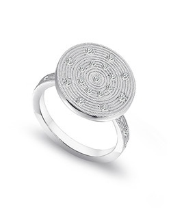 Sholdt platinum fashion ring with diamond accents and a hand-milled surface.