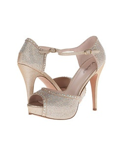 "Ankle strap peep toe sandal with stones. Heel: 5 1/2"" - 1 1/2"" Platform."
