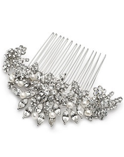 This bridal comb features not only lustrous white pearls but also scores of diminutive round cut rhinestones and six generously sized marquise cut gems set in a starburst pattern.