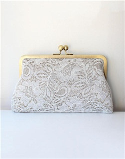 Taking cues from classic French lingerie, the Antoinette clutch is draped in delicate lace, adding interest and texture. Ivory lace atop taupe and gray sage for the lining. An antique brass clasp is the finishing touch.