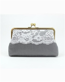 Our young ingenue, the Bijou Clutch is sugar, spice and everything nice, as sheer lace with delicate edging contrasts the body of this clutch.