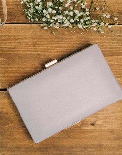 Luxe lilac leather envelopes this box clutch with a pearlescent glow. Featuring a navy lining and gold clasp, this clutch includes a wristlet chain for two looks in one.