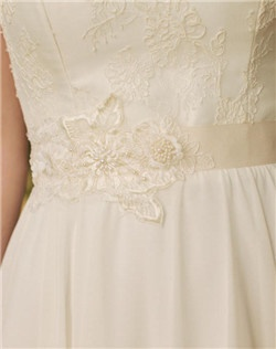 Delicate lace appliques overlay one another in a beautiful floral collage. Pearls and crystalline beads catch the light with a hint of shimmer, creating a beautiful wedding day accessory. Finished with your choice of ivory grosgrain or satin ribbon, this belt is made to measure with a hook and eye closure.