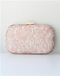 Swirls of blush sequins punctuate delicate blush and ivory lace like tiny champagne bubbles. Featuring an ivory lining and gold clasp, this clutch is finished with a wristlet chain for two looks in one.
