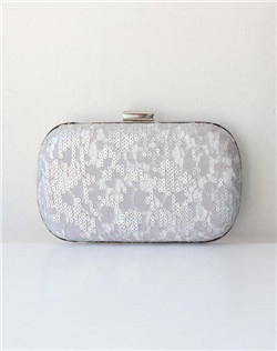 Swirls of silvery sequins punctuate delicate gray lace like tiny champagne bubbles. Featuring a mint lining and nickel clasp, this clutch is finished with a wristlet chain for two looks in one.