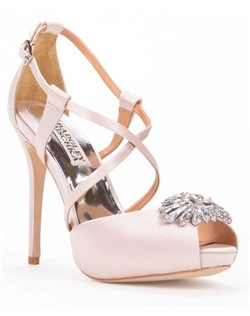"This gorgeous pair of satin wedding pumps from Badgley Mischka, called the Hilary, feature a stunning soft pink hue and a sexy 4 1/4"" stiletto heel. Criss-cross ankle straps are attached to the closed heel, and a pretty vintage-inspired rhinestone embellishment is secured at the toe. An interior platform at the sole adds a sense of comfort and stability."