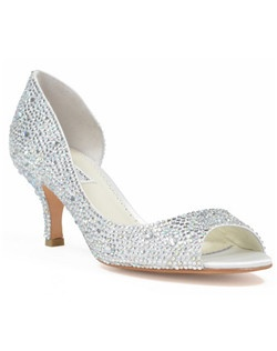 "The Divine shoe, by designer Benjamin Adams, is a delicate and glamorous white shoe covered in Austrian crystals. The open-toe shoe features an elegant but practical 2 1/2"" heel, and a lovely wrap-around silhouette that opens up in the insole."