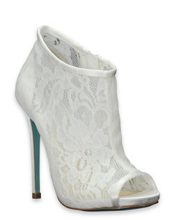 "Betsey Johnson comes one of the most head-turning wedding shoes on the market: her RSVP lace bootie. The glamorous shoe features a 4 5/8"" heel, a 3/4"" platform, and a peep-toe, along with an insole zipper making it easy to slide on and off. The exterior is crafted from an ivory lace; a satin toe and heel complete the look. Finally, the visible sole is a light blue color and features her signature silver metal heart medallion."