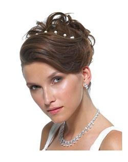 These miniature jeweled hair twists are a wonderful way to add sparkle to any wedding 'do. A variety of colors means that your whole bridal party can wear them to coordinate with their eyes, hair color, dress color... a rainbow of colors to choose from. Clip neatly in your hair along the top to create a floating tiara affect, or wear strewn throughout your locks for a more natural Flower Power look.