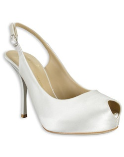 "This glamorous ivory silk slingback pump, from Giuseppe Zanotti designs, features a peep-toe and a 3 1/2"" ivory heel. A substantial inner platform adds comfort and stability while a slingback strap offers a pretty exposed heel."