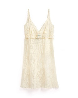 You'll definitely keep the newlywed spirit alive in this curve-hugging white lace chemise. We love the extra-feminine details like scalloped lace trim at the hem and a flirty ruffle at the empire waistline. Made of 100% nylon, it hits at a flattering mid-thigh length. Available in XS, S, M, L. Hand-wash only.