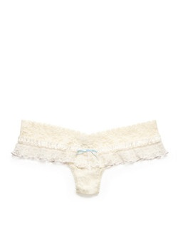 "No matter what your wedding gown looks like, you can't go wrong with a romantic, ruffled thong. The dainty blue bow and ivory hue say """"bride,"""" but the thong's low rise and stretchy lace make it just as comfy as your everyday undies -- meaning you'll definitely wear them again. One size (fits 4-14). Hand-wash only.
