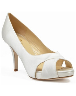 "This classic kate spade bridal shoe, the Billie, is perfect for the bride who wants a little lift from a platform and a pretty open-toe. The ivory silk shoe features a 1/2"" platform at the toe and a 3"" heel. The cross strap over the top of the foot works beautifully for spring, summer, or autumn weddings."