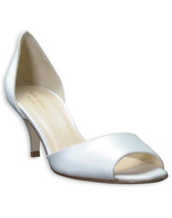 "The Eden pump from kate spade is a picture of simple, understated and versatile elegance. The silk satin shoe features a graceful open-toe and a pretty and slight revealing d'orsay heel. A 2 1/4"" heel is practical enough to make for a comfy walk down the aisle."