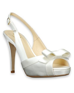"From kate spade comes the beautiful and versatile Grano slingback bridal shoe! The shoe is covered with ivory silk and features a 4"" heel and her signature tailored bow at the peep-toe."